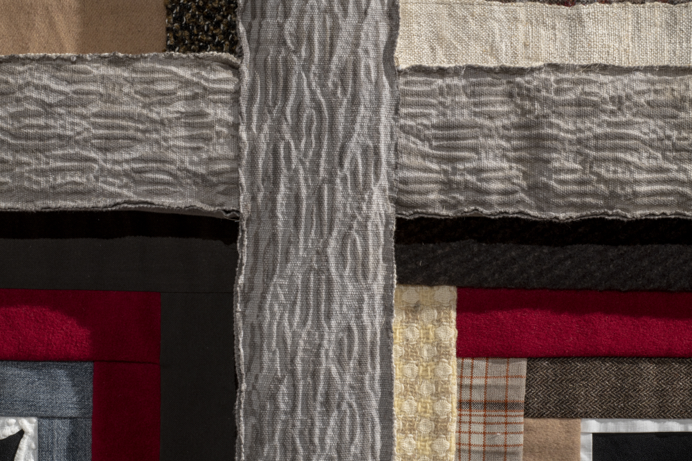 Echo 2: Deconstruction 2018 (detail) - 6 log cabin patchwork squares composed of used clothing, joined by hand-woven shibori-dyed cotton-linen strips, the latter raised and stuffed for a coffered effect. 183 x 122 x 7 cm (photo credit: Steve Farmer)