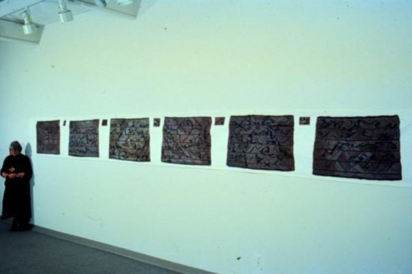 Ann Newdigate. Ciphers from the Muniments Room- Letter (installation view) 26-inch x 22-foot digital printout, automobile paint on canvas (1994)