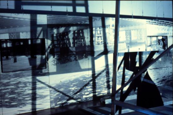 Claire Paquet and Suzanne Paquet. Comme les jours précédents, les géographies du transitoire (installation view). Black and white photographs, aluminium scaffolding, light source (1996)