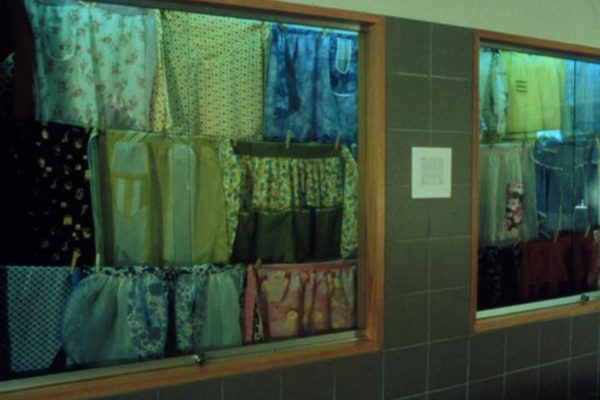 Gillian Collyer. Aprons Away. installation view. Hostess aprons, clothes lines, pegs (1998)