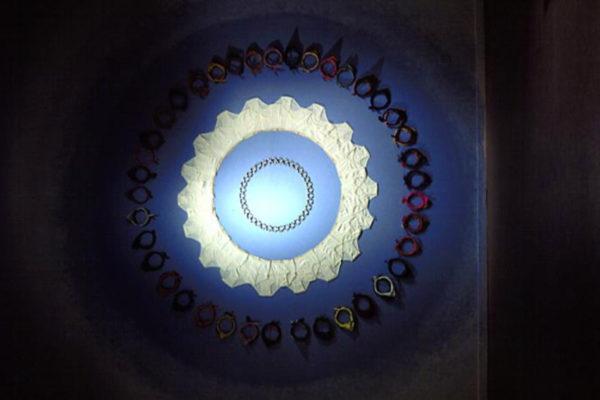 Neil MacInnis. Mandala-Narcissus. Men's briefs, metal and rubber cock rings, workers' bandannas, diameter 450 cm (1996)