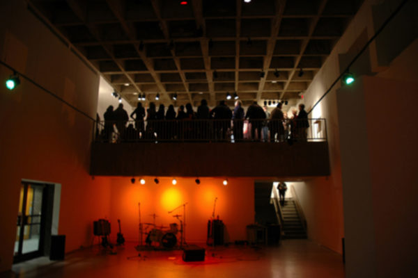 Bite and Burn, encore peformance at MSVU Art Gallery on 10 January 2009, viewed from lower gallery and showing set-up for the Halifax band, Realiser (2009)