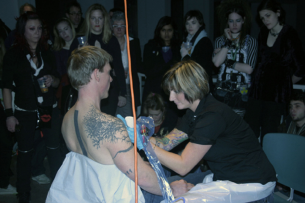 Bite and Burn, encore performance with Jason Fitzpatrick, Amber Thorpe (tattooist), Dax Morrison (printmaker), and Stefan Hancherow (print runner) at MSVU Art Gallery on 10 January '09 #4 (2009)