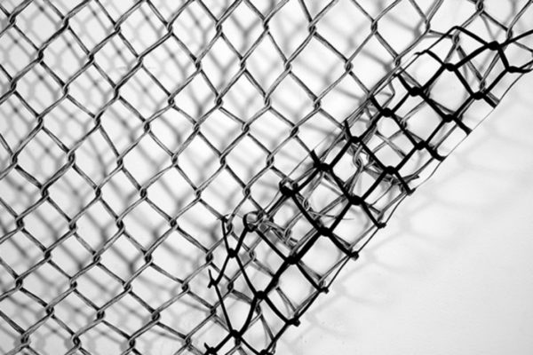 Melanie Colosimo, Chain-Link Fence (detail) white chalk on black paper with sections cut out 202.28 x 264.16 cm (2014)