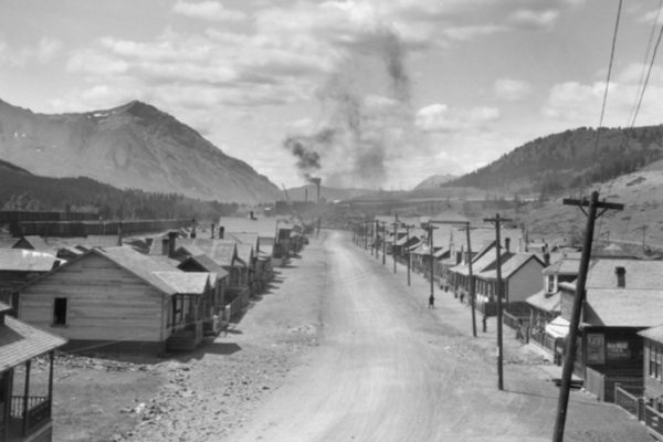 Thomas Gushul. Street with McGillivray Creek Mine Tipple in the distance, Coleman. Glenbow Museum and Archives, NC-54-2926 (1930)