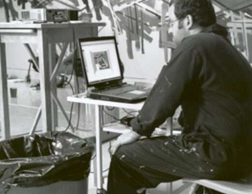Tracking painting installation, MSVU Art Gallery, work in progress, August 2004- Painting Assistant Renato Vitic checks the digital design on the computer. Photo- Gary Castle (2004)