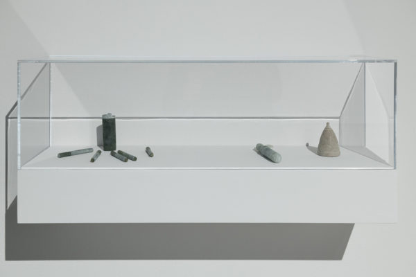 Kablusiak, Cigarettes and Lighter, 2017; Tampax® tampon, 2017; Menstrual cup, 2017. From the series Uyarak/Stone. Installation view at Leonard & Bina Ellen Art Gallery, 2019.