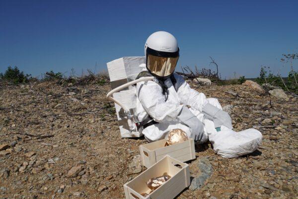 Daniel H. Dugas & Valerie LeBlanc, Astronaut with Rocks, 2018.  Location photo.